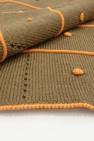 Copertina in lana merinos con ricami